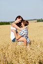Happy couple in love outdoor in summer on field Royalty Free Stock Photography