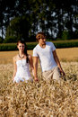 Happy couple in love outdoor in summer on field Royalty Free Stock Image