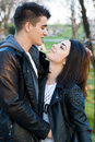 Happy couple in love outside sensual a park looking at each other Royalty Free Stock Image