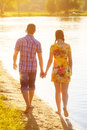 Happy couple in love walking on the beach. Summer vacations conc Royalty Free Stock Photo