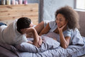 Happy couple lying in bed together Royalty Free Stock Photo