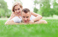 Happy couple lying on grass Stock Photo