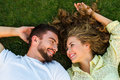 Happy couple lying on the grass. Royalty Free Stock Photo