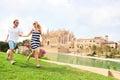 Happy couple on mallorca la seu palma cathedral in front of travel majorca vacation holiday running having fun laughing Stock Photos