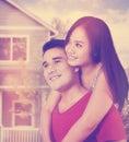Happy couple near new house Royalty Free Stock Photo
