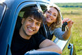 Happy couple in new car Royalty Free Stock Photography