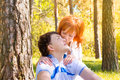 Happy couple outdoor beautiful sensual in love posing in spring summer park sunny weather young boy and girl having fun Stock Photos