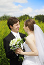 Happy couple outdoors looking each other Royalty Free Stock Images
