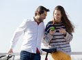 Happy couple outside looking at text message on cell phone Royalty Free Stock Photo