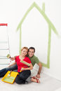 Happy couple painting in their home Royalty Free Stock Photo