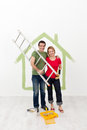 Happy couple painting their home preparing utensils Royalty Free Stock Photo