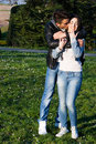 Happy couple in a park hugging love and smiling Stock Images