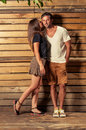 Happy couple in photo shooting outdoor on wooden background Royalty Free Stock Photo