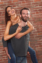 Happy Couple Piggybacking his Beautiful Girlfriend Stock Image