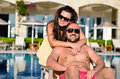 Happy  couple    on a pool Royalty Free Stock Photo