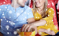Happy couple with popcorn in movie theater Royalty Free Stock Photo