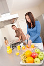 Happy couple preparing food in the kitchen Stock Photos