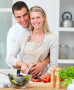 Happy couple  preparing food in the kitchen Royalty Free Stock Photography