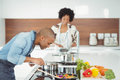 Happy couple preparing meal in the kitchen Stock Photography