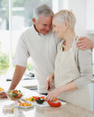 Happy couple preparing a meal together at home Royalty Free Stock Photo