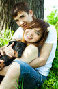 Happy couple with a puppy Royalty Free Stock Photo