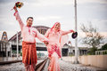 Happy couple on railway track newly wedded posing Royalty Free Stock Images
