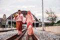 Happy couple on railway track newly wedded posing Stock Photography