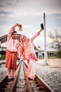 Happy couple on railway track newly wedded posing Royalty Free Stock Photo