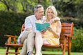 Happy couple reading a book Royalty Free Stock Photo