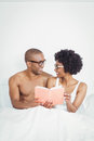 Happy couple reading a book together on the bed Royalty Free Stock Photography