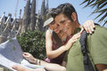 Happy couple reading map together young at barcelona Royalty Free Stock Photo