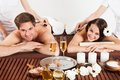 Happy Couple Receiving Shoulder Massage At Beauty Spa Royalty Free Stock Photo
