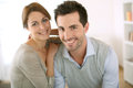 Happy couple relaxing at home portrait of smiling loving Stock Images