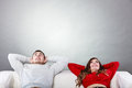 Happy couple relaxing resting on couch at home. Royalty Free Stock Photo
