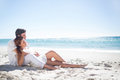 Happy couple relaxing together in the sand at beach Royalty Free Stock Image