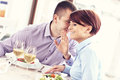 Happy couple in a restaurant picture of young sitting and talking Stock Image