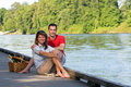 Happy Couple by a River - Horizontal Stock Photos