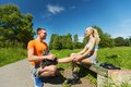 Happy couple with rollerblades outdoors Royalty Free Stock Photo