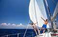 Happy couple on sailboat having fun Stock Image
