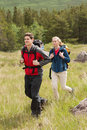 Happy couple setting out on a hike in the countryside Royalty Free Stock Photography