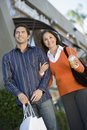 Happy Couple With Shopping Bags Stock Photography