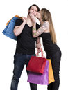 Happy couple with shopping bags on a white background Royalty Free Stock Photo
