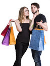 Happy couple with shopping bags on a white background Royalty Free Stock Photos