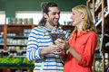 Happy couple shopping for groceries Royalty Free Stock Photo