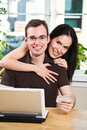 Happy couple shopping online Royalty Free Stock Images