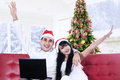 Happy couple shopping online young buying christmas gift at home Stock Images