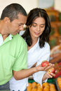 Happy couple shopping in supermarket Royalty Free Stock Photo