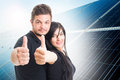 Happy couple showing like on solar power photovoltaic panel back Royalty Free Stock Photo