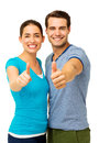 Happy couple showing thumbs up sign portrait of over white background vertical shot Stock Photo
