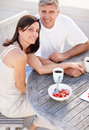 Happy couple sitting together and having breakfast Royalty Free Stock Photography